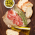 bruschetta ingredients   prosciutto olives and olive oil stock photo © karandaev