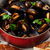 Mussels and bread stock photo © karandaev