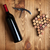 red wine bottle corkscrew and grape shaped corks stock photo © karandaev