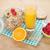healthy breakfast with muesli berries and orange juice stock photo © karandaev