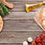 pizza with prosciutto and tomatoes stock photo © karandaev
