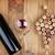 red wine bottle glass and grape shaped corks stock photo © karandaev