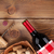 red wine bottle bowl with corks and corkscrew view from above stock photo © karandaev
