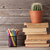 cactus on old books and colorful pencils stock photo © karandaev