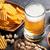 cerveza · aperitivos · piedra · mesa · nueces - foto stock © karandaev
