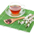 japanese green tea and sakura branch over bamboo mat stock photo © karandaev