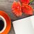 blank notepad coffee cup and orange gerbera flowers stock photo © karandaev