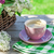 coffee cup and colorful lilac flowers stock photo © karandaev