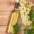 white wine bottle and bunch of white grapes stock photo © karandaev