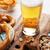 világos · sör · sör · harapnivalók · fa · asztal · diók · sültkrumpli - stock fotó © karandaev