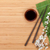 chopsticks sakura branch soy sauce and bamboo mat stock photo © karandaev