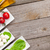 tomatoes mozzarella and green salad leaves with condiments stock photo © karandaev
