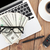 office table with pc coffee cup glasses and money cash stock photo © karandaev