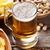 cerveja · lanches · caneca · mesa · de · madeira · nozes - foto stock © karandaev