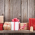 christmas gift boxes in front of wooden wall stock photo © karandaev