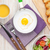 Healthy breakfast with fried egg, toasts and salad stock photo © karandaev