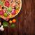 italian pizza with pepperoni tomatoes olives and basil stock photo © karandaev
