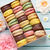 colorful macaroons in a gift box and roses stock photo © karandaev