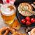 beer mug grilled shrimps sausages and pretzel stock photo © karandaev