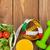dumbells tape measure and healthy food over wooden table stock photo © karandaev