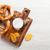 zoute · krakeling · snacks · olijfolie · hout · kom · geïsoleerd - stockfoto © karandaev