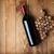 vinho · tinto · garrafa · vidro · uva · mesa · de · madeira - foto stock © karandaev