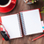 desk with notepad coffee and headphones stock photo © karandaev
