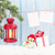 christmas candle lantern gift box and blank photos stock photo © karandaev