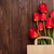 red tulips bouquet in bag over wood stock photo © karandaev