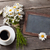 blackboard flowers and coffee cup stock photo © karandaev