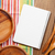 wood kitchen utensils with notepad for copy space stock photo © karandaev
