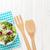 fresh healthy salad over white wooden table stock photo © karandaev