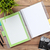 office desk with calendar notepad camera supplies and flower stock photo © karandaev