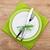 fork with knife over plates stock photo © karandaev