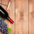 red wine bottle and bunch of red grapes stock photo © karandaev