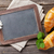 blackboard for your text and croissants stock photo © karandaev
