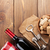 red wine bottle corks and corkscrew over wooden table backgroun stock photo © karandaev