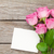 pink roses bouquet and blank greeting card over wooden table stock photo © karandaev