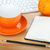 Coffee cup, orange fruit and office supplies stock photo © karandaev