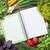 fresh garden herbs and notepad for recipes stock photo © karandaev