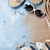 пляж · Солнцезащитные · очки · морем · снарядов · каменные - Сток-фото © karandaev