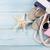 zomerschoenen · strand · zeester · wit · zand · vrouw · mode - stockfoto © karandaev