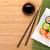 sushi · maki · eetstokjes · geïsoleerd · witte · plaat - stockfoto © karandaev