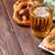 pretzel beer mug and grilled shrimps stock photo © karandaev