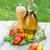 olive oil bottle pepper shaker tomatoes and herbs stock photo © karandaev
