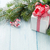 christmas gift box and fir tree branch stock photo © karandaev