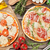 pizza with prosciutto tomatoes and mushrooms stock photo © karandaev