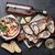 fresh seafood and white wine on stone table stock photo © karandaev