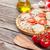 pizza with tomatoes and mushrooms stock photo © karandaev