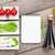 tomatoes mozzarella and green salad leaves with notepad for cop stock photo © karandaev